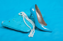 Beautiful Blue Shoes And Handbag, Pearls On Blue Background
