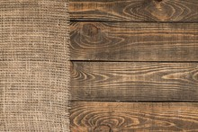 Background. Burlap Texture On Wooden Table Background