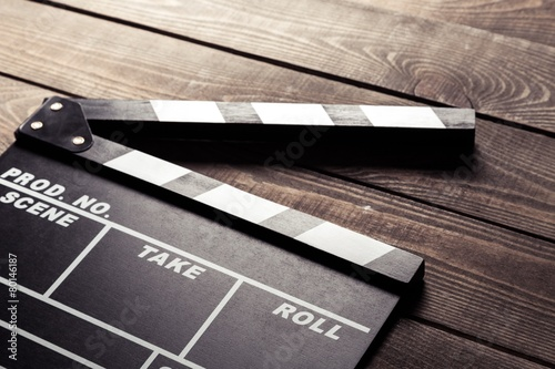 Production. vintage photo of movie clapper on wood