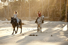 Women Riding Horses On The Beach