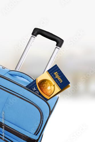 Fényképezés Algiers. Blue suitcase with guidebook.