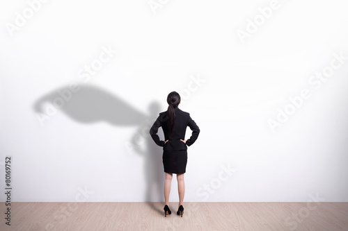 Superhero business woman looking Wallpaper Mural
