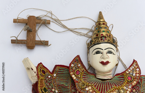 Photo  Burmese puppet with rope on white background