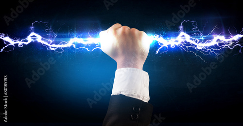 Business man holding electricity light bolt in his hands