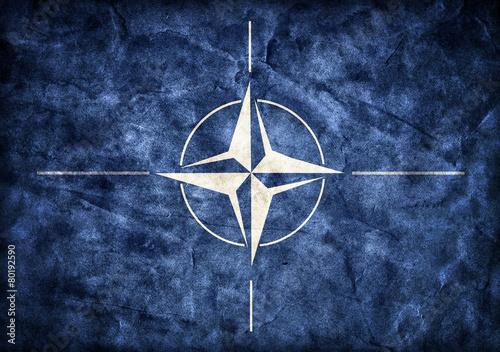 Photo  Grunge NATO flag, parchment paper texture.