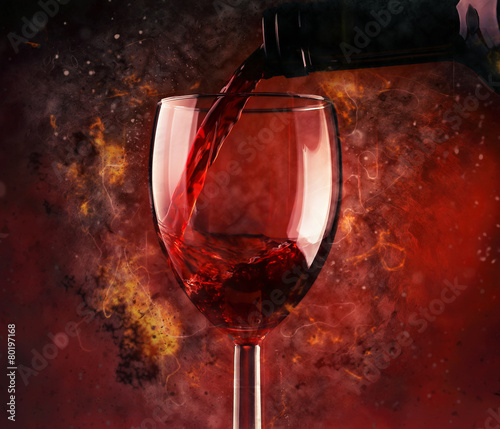 Pouring red wine and fire background