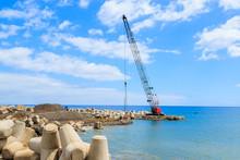 Crane On Coast Of Madeira Island In Funchal Port