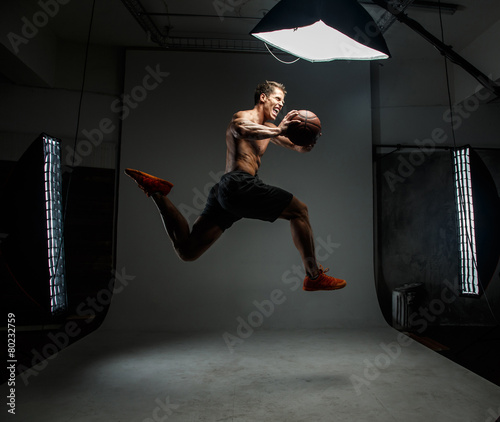 Guy with basket ball in action