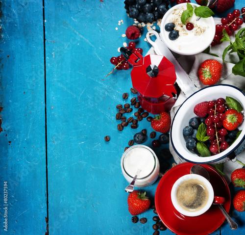 Healthy breakfast - yogurt with muesli and berries - health and