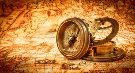 Obraz na Plexi Vintage compass lies on an ancient world map.