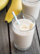 Banana milkshake on wooden background