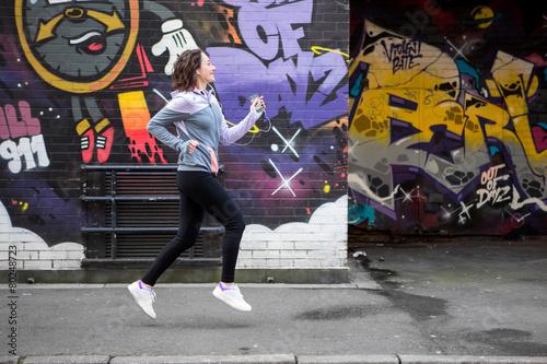 Foto op Aluminium Grandfailure Young attractive woman running downtown