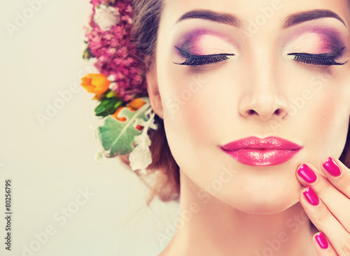 Fototapeta Girl with delicate  flowers in hair and fashion  fuchsia nail obraz