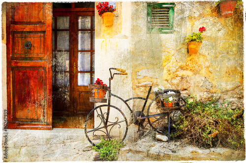Fotobehang Fiets charming street in Valdemossa village with old bike