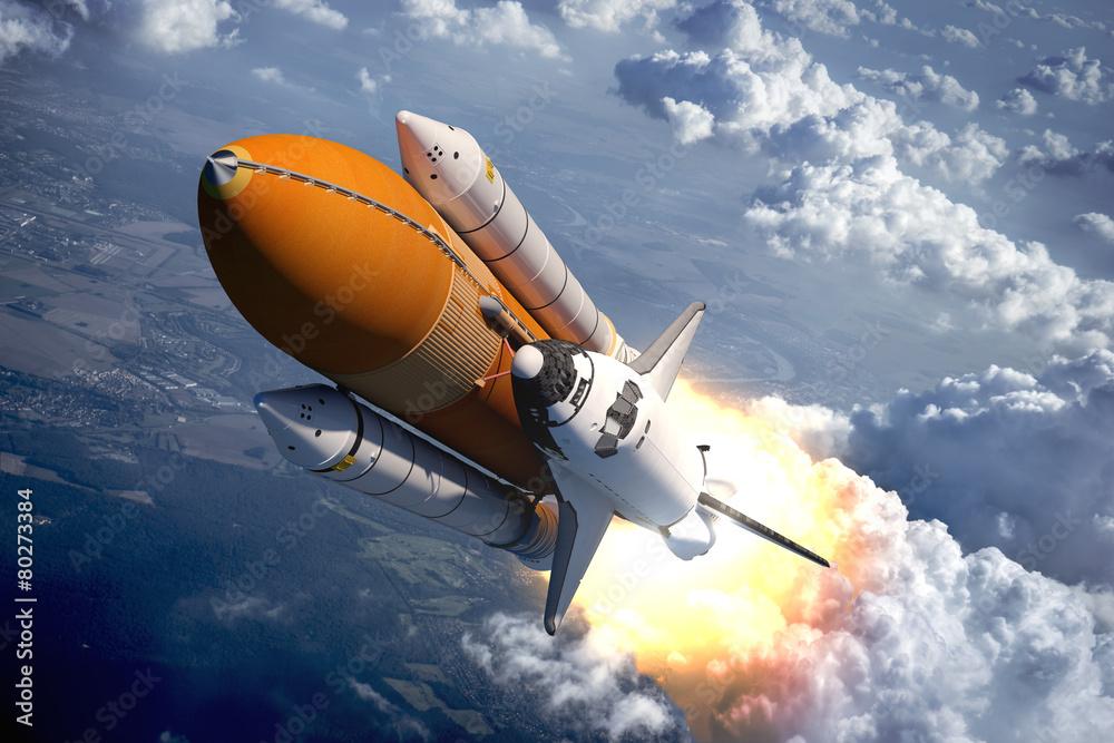 Fototapeta Wahadłowiec latający nad chmurami - obraz na płótnie