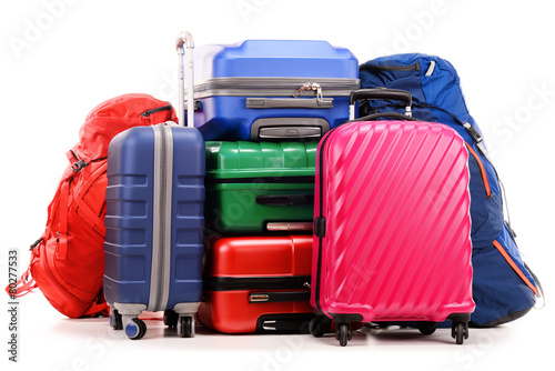 Photo Suitcases and rucksack isolated on white