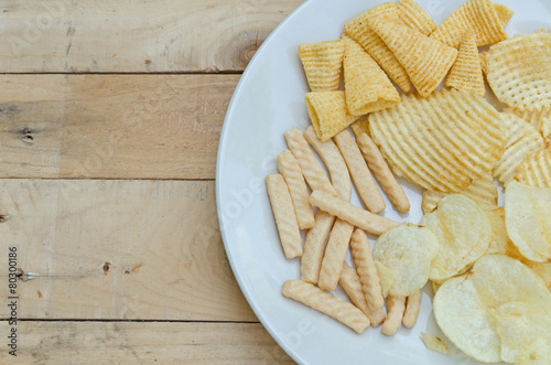 Valokuva  Mix snacks in dish on wood background