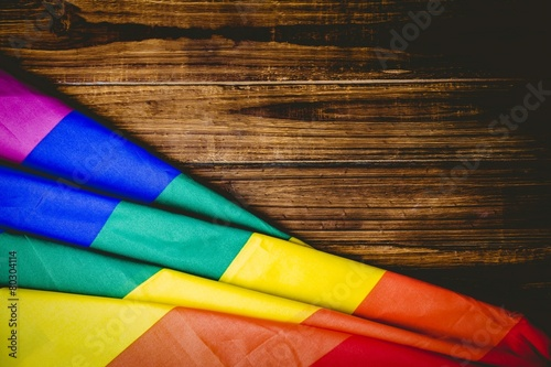 Photo Gay pride flag on wooden table