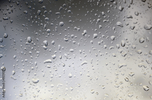Raindrops on the windshield of the car