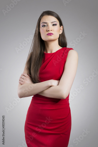 Fotografie, Obraz  Priggish young woman with arms crossed