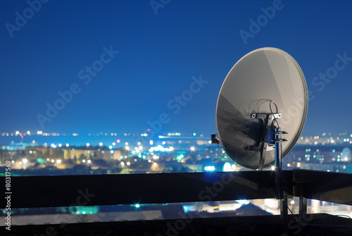 Fotografie, Tablou  Satellite dish antenna on rooftop at night