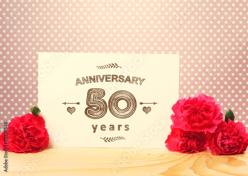 50 years anniversary card with pink carnations buy this stock