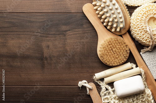 some bath accessories on brown wooden background Fototapete