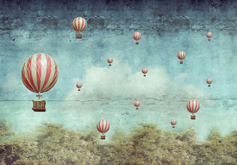 FototapetaHot air ballons flying over a forest