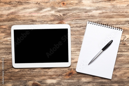Tela  Analysis. Digital tablet on wooden tablets with notepad and pen