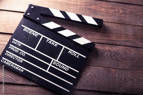 Cinema. vintage photo of movie clapper on wood #80341146
