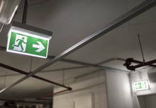 Indication Of The Way To The Emergency Exit In A Parking Garage