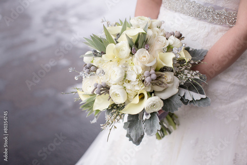 Fotografie, Obraz  Bride Holding a Bouquet of Flowers