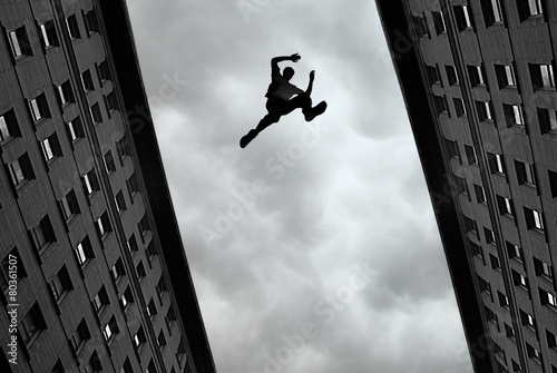 Man jumping from roof to roof