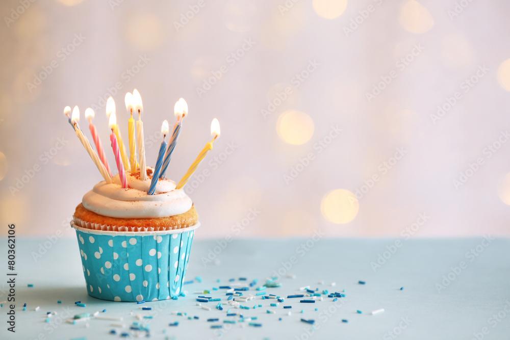 Fotografia, Obraz  Delicious birthday cupcake on table on light background