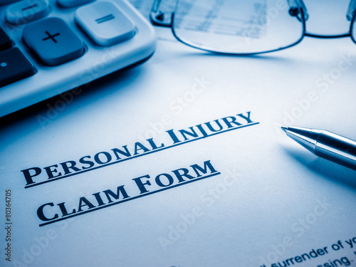 personal injury claim form on desk.