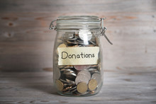 Money Jar With Donations Label.