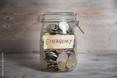 Fototapeta Money jar with emergency label. obraz