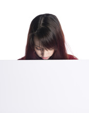 Young Woman Looking Down At Blank White Board