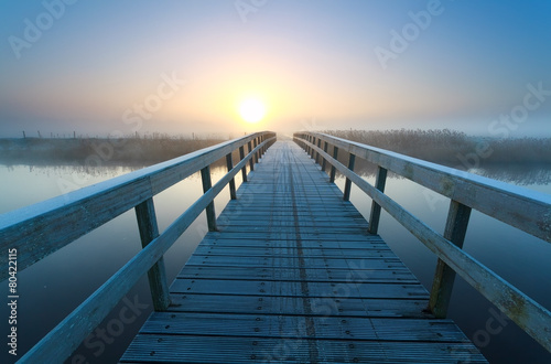 Staande foto Brug bridge to sunrise sun