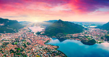 Fototapeta Krajobraz Colorful summer sunrise on the city and lake Lecco