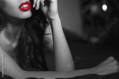 Cuadros en Lienzo Sexy woman with red lips closeup in selective black and white