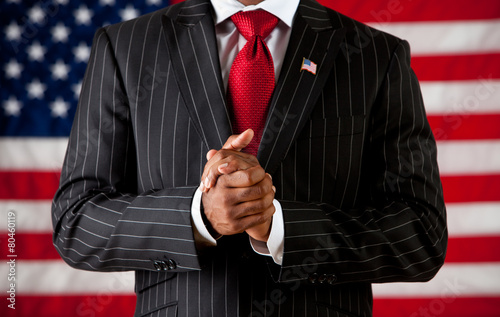 Leinwand Poster Politician: Man with Hands Clasped