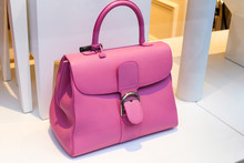 Pretty Pink Lady's Handbag On The Display Window In The Store