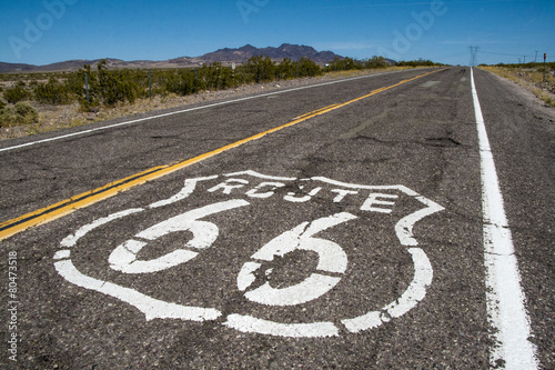 long road with a Route 66 sign painted on it