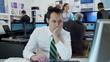 Bored and sleepy businessman struggles to stay awake at work
