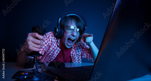 Photo  Emotional kid play video game