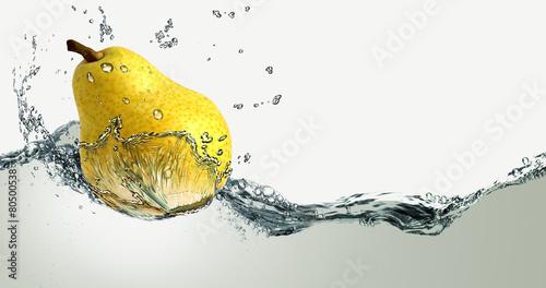 Obraz na plátně Ripe pear and splashes of water.
