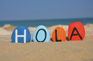 FototapetaHola, hello in spanish language on colored stones