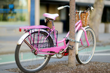 Fancy Pink Bike Parked By A Tree In New York