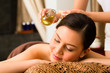 canvas print picture - Chinese Woman at wellness massage with essential oils